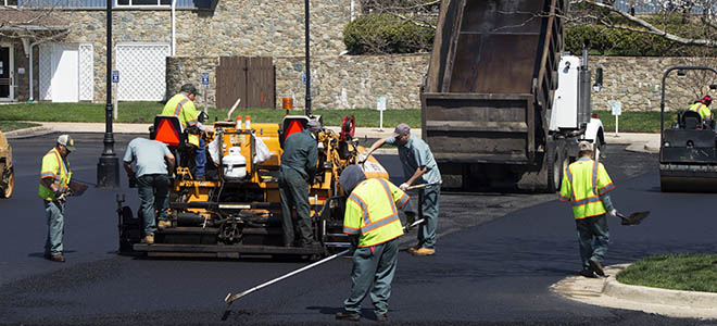 Dominion Pavers working on the road